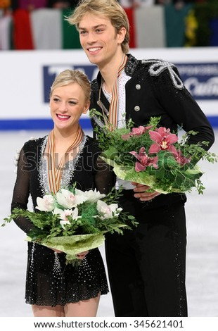 BUDAPEST, HUNGARY - JANUARY 16, 2014: Penny COOMES / Nicholas BUCKLAND pose at the victory ceremony at ISU European Figure Skating Championship in Syma Hall Arena. - stock photo