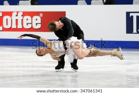 BUDAPEST, HUNGARY - JANUARY 16, 2014: Pernelle CARRON / Lloyd JONES of France perform free dance at ISU European Figure Skating Championship in Syma Hall Arena.