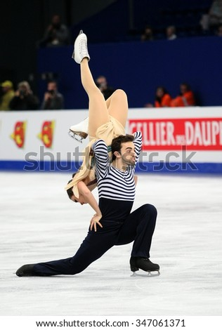 BUDAPEST, HUNGARY - JANUARY 16, 2014: Sara HURTADO / Adria DIAZ of Spain perform free dance at ISU European Figure Skating Championship in Syma Hall Arena. - stock photo