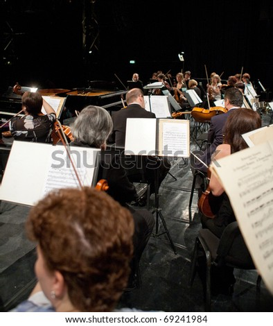BUDAPEST, HUNGARY - JANUARY 15: The MAV Symphonic Orchestra performs at The Millenaris stage on January 15, 2011 in Budapest, Hungary. Conductor: Laszlo Kovacs - stock photo