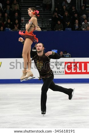 BUDAPEST, HUNGARY - JANUARY 19, 2014: Vera BAZAROVA / Yuri LARIONOV of Russia perform free program at ISU European Figure Skating Championship in Syma Hall Arena.