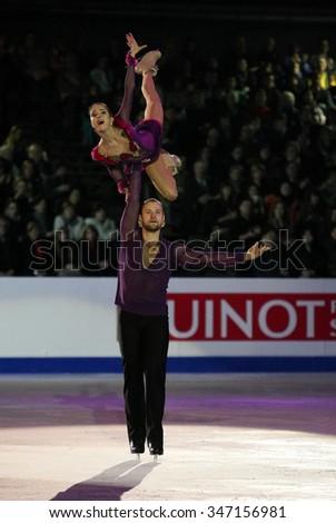 BUDAPEST, HUNGARY - JANUARY 19, 2014: Vera BAZAROVA / Yuri LARIONOV perform during the exhibition gala at ISU European Figure Skating Championship in Syma Hall Arena. - stock photo