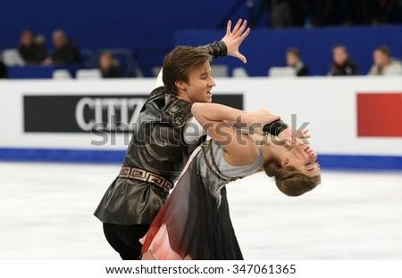 BUDAPEST, HUNGARY - JANUARY 16, 2014: Victoria SINITSINA / Ruslan ZHIGANSHIN of Russia perform free dance at ISU European Figure Skating Championship in Syma Hall Arena. - stock photo