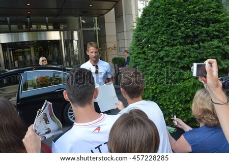 BUDAPEST, HUNGARY-  JULY 24: F1 driver Jenson Button is among his fans and giving autographs on July 24, 2016 in Budapest. - stock photo