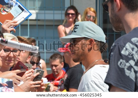 BUDAPEST, HUNGARY-  JULY 21: F1 driver Lewis Hamilton is among his fans and giving autographs on July 21, 2016 in Budapest.