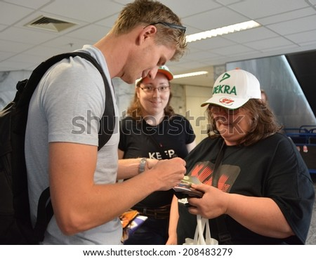 BUDAPEST, HUNGARY-  JULY 24: F1 driver Nico Halkenberg is among his fans and giving autographs on July 24, 2014 in Budapest. - stock photo