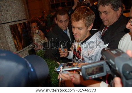 BUDAPEST, HUNGARY-  JULY 30: F1 driver Sebastian Vettel is among his fans and giving autographs on July 30, 2011 in Budapest, Hungary.