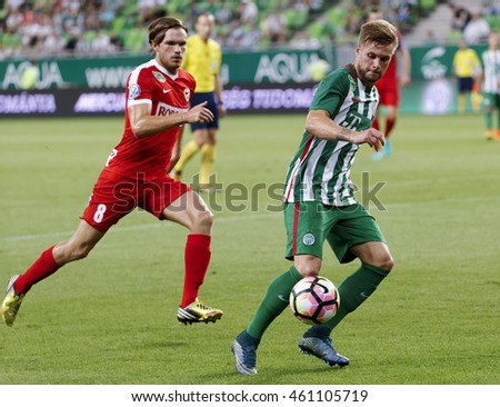 BUDAPEST, HUNGARY - JULY 30, 2016: Florian Trinks (R) of Ferencvarosi TC leaves Balint Olah #8 of DVTK behind during the OTP Bank Liga match between Ferencvarosi TC and DVTK at Groupama Arena.