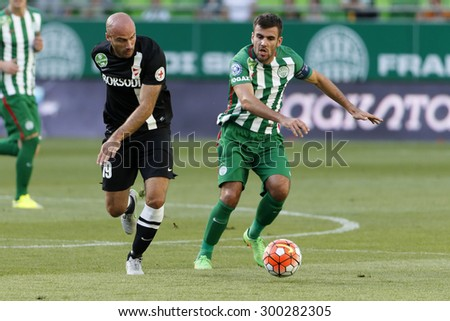BUDAPEST, HUNGARY - JULY 26, 2015: Gabor Gyomber of Ferencvaros (r) and Miroslav Grumic of DVTK run after the ball during Ferencvaros vs. DVTK OTP Bank League football match in Groupama Arena.  - stock photo