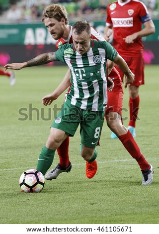 BUDAPEST, HUNGARY - JULY 30, 2016: Gergo Lovrencsics #8 of FTC fights for the ball with Patrik Bacsa (L) of DVTK during the OTP Bank Liga match between Ferencvarosi TC and DVTK at Groupama Arena.