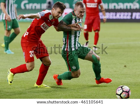 BUDAPEST, HUNGARY - JULY 30, 2016: Gergo Lovrencsics (R) of FTC duels for the ball with Milan Nemes #33 of DVTK during the OTP Bank Liga match between Ferencvarosi TC and DVTK at Groupama Arena.