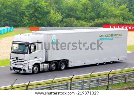 BUDAPEST, HUNGARY - JULY 27, 2014: Grey semi-trailer truck Mercedes-Benz Actros of the Mercedes AMG Petronas F1 racing team.