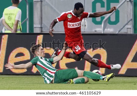BUDAPEST, HUNGARY - JULY 30, 2016: Michal Nalepa (L) of Ferencvarosi TC slide tackles Georges Griffiths #50 of DVTK during the OTP Bank Liga match between Ferencvarosi TC and DVTK at Groupama Arena.