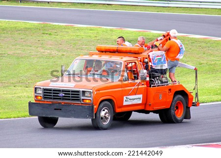 BUDAPEST, HUNGARY - JULY 26, 2014: Orange technical rescue truck Ford F-150 at the Hungaroring Formula One Race Track. - stock photo