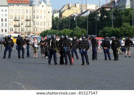 BUDAPEST, HUNGARY - JULY 5. Police in full riot gear protects the participants of the Budapest Gay Pride from aggression of counter-demonstrators, on July 5, 2008 in Budapest, Hungary.