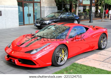 BUDAPEST, HUNGARY - JULY 23, 2014: Red supercar Ferrari 458 Italia Speciale at the city street. - stock photo