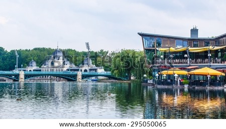 BUDAPEST, HUNGARY, JULY 29, 2014: restaurant is being reflected on water of pond in varosliget parc in budapest, hungary.