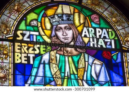 BUDAPEST, HUNGARY, JULY 9, 2015: Stained glass portrait of Szt. Erzsebet inside St. Stephen's Basilica, Budapest, Hungary. - stock photo