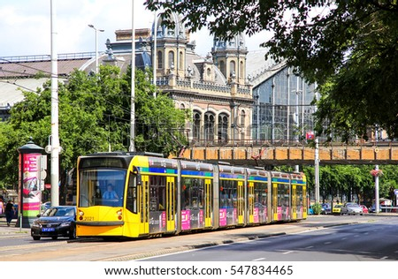 BUDAPEST, HUNGARY - JULY 23, 2014: Yellow articulated tramway Siemens Combino Supra NF12B in the city street.