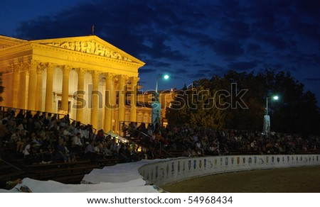 BUDAPEST, HUNGARY - JUNE 7: Crowd waiting for start of night fire show before National Fine Art Museum at racetrack of National Gallop on Heroes' Square on 7th of June, 2010 in Budapest, Hungary