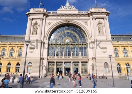 BUDAPEST, HUNGARY - JUNE 20, 2014: People visit Keleti Station in Budapest. Keleti is the Eastern railway station, was opened in 1884 and is among largest in Europe.