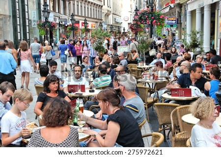 BUDAPEST, HUNGARY - JUNE 19, 2014: People visit Vaci Street in Budapest. 3.3 million people live in Budapest Metropolitan Area. It is the largest city in Hungary and 9th largest in the EU. - stock photo