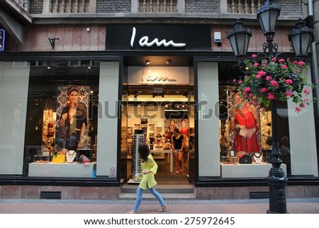 BUDAPEST, HUNGARY - JUNE 19, 2014: Person walks by I Am fashion store in Budapest. I Am is a part of Beeline Group which operates 390 stores in 39 countries.