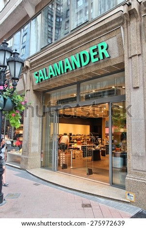 BUDAPEST, HUNGARY - JUNE 19, 2014: Person walks by Salamander shoe fashion store in Budapest. Salamander is part of Ara Group and operates 200 stores in Europe.