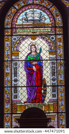 BUDAPEST, HUNGARY - JUNE 10, 2016 Saint Catherine Stained Glass Saint Stephens Cathedral Budapest Hungary.  St Catherine a Christian Martyr died in 400 AD. Cathedral built in the 1800s . - stock photo
