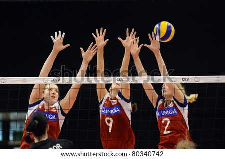 BUDAPEST, HUNGARY - JUNE 18: Unidentified players in action at a CEV European League woman's volleyball game Hungary vs Czech Republic on June 18, 2011 in Budapest, Hungary.