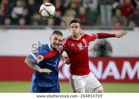 BUDAPEST, HUNGARY - MARCH 29, 2015: Air battle between Hungarian Zoltan Stieber (r) and Greek Kostas Stafylidis during Hungary vs. Greece UEFA Euro 2016 qualifier football match in Groupama Arena.
