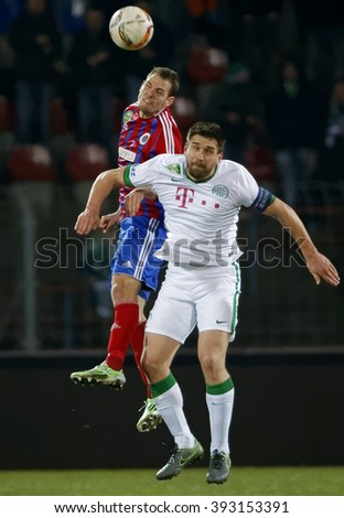 BUDAPEST, HUNGARY - MARCH 19, 2016: Air battle between Zsolt Korcsmar of Vasas (l) and Daniel Bode of Ferencvaros during Vasas - Ferencvaros OTP Bank League football match at Illovszky Stadium. - stock photo