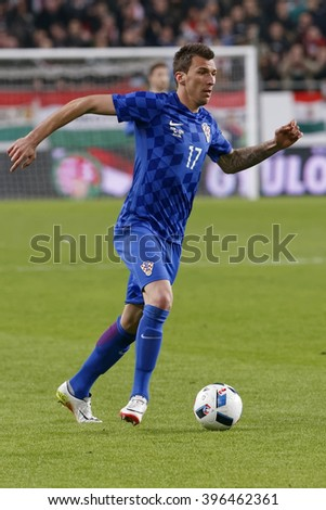 BUDAPEST, HUNGARY - MARCH 26, 2016: Croatian Mario Mandzukic is with the ball during Hungary vs. Croatia international friendly football match in Groupama Arena.