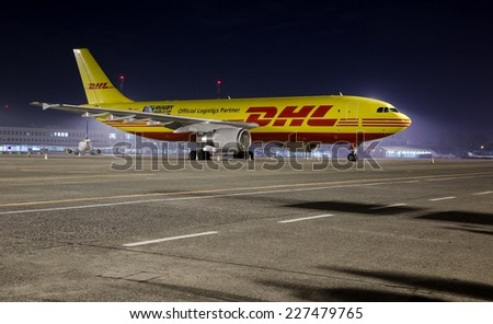 BUDAPEST, HUNGARY - MARCH 5: DHL Airbus A300 cargo plane at Budapest Airport, March 5th 2014. DHL is a world market leader in air mail - stock photo