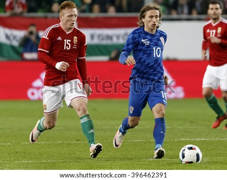 BUDAPEST, HUNGARY - MARCH 26, 2016: Hungarian Laszlo Kleinheisler (l) and Croatian Luka Modric run after the ball during Hungary vs. Croatia international friendly football match in Groupama Arena.