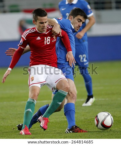 BUDAPEST, HUNGARY - MARCH 29, 2015: Hungarian Zoltan Stieber (l) is tackled by Greek Sokratis Papastathopoulos during Hungary vs. Greece UEFA Euro 2016 qualifier football match in Groupama Arena.