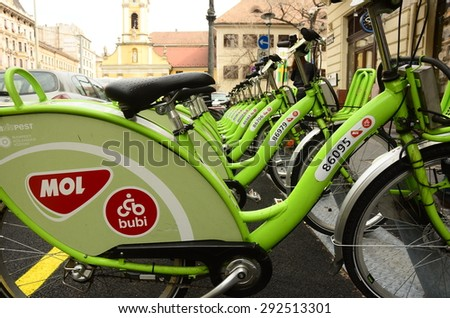 BUDAPEST, HUNGARY - MARCH 27: MOL BuBi public bicycle system bicycles docked for hire on March 27, 2015 in Budapest, Hungary. The Budapest BuBi scheme includes 1,100 bicycles for public hire. - stock photo