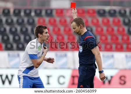 BUDAPEST, HUNGARY - MARCH 14, 2015: Robert Feczesin of Videoton kicks the ball between Jozsef Kanta (l) and Adam Vass (r) of MTK during MTK vs Videoton OTP Bank League football game in Bozsik Stadium