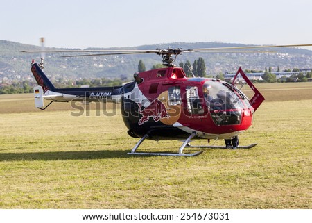 BUDAPEST HUNGARY - MAY 3: A Red Bull aerobatic helicopter demonstrates different flying techniques, for civilian as well as some air force personnel on May 1 2014 Hungary.  - stock photo