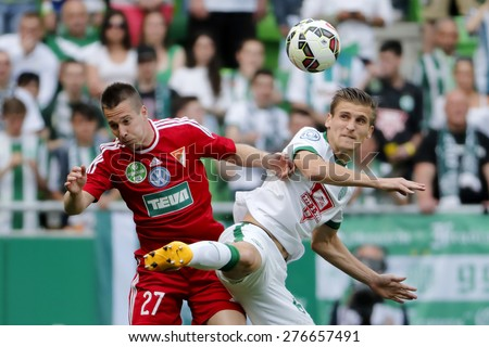 BUDAPEST, HUNGARY - MAY 10, 2015: Air battle between Emir Dilaver of Ferencvaros (r) and Adam Bodi of DVSC during Ferencvaros vs. DVSC OTP Bank League football match in Groupama Arena.  - stock photo