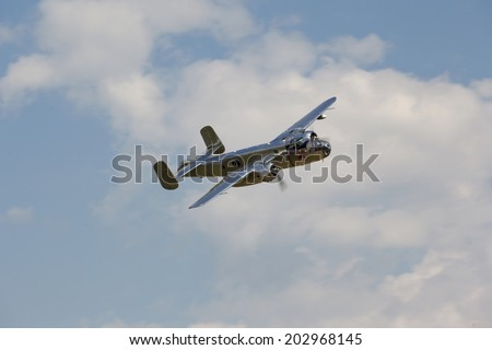 BUDAPEST, HUNGARY - MAY 1: B-25 Mitchell historic bomber plane fly-by with Red Bull marking on it's fuselage on May1, 2014 in Hungary - stock photo