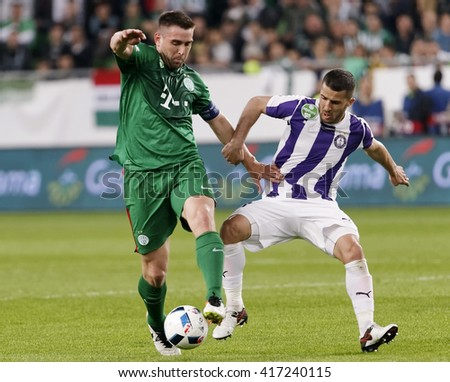 BUDAPEST, HUNGARY - MAY 7, 2016: Bojan Sankovic (R) of Ujpest fights for the ball with Daniel Bode of Ferencvaros during the Hungarian Cup Final match between Ujpest and Ferencvarosi at Groupama Arena - stock photo