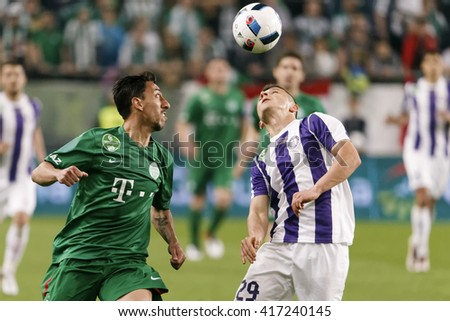 BUDAPEST, HUNGARY - MAY 7, 2016: Enis Bardhi (R) of Ujpest and Leandro of Ferencvaros watch the ball in the air during the Hungarian Cup Final match between Ujpest and Ferencvaros at Groupama Arena - stock photo
