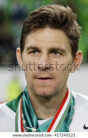 BUDAPEST, HUNGARY - MAY 7, 2016: Goal scorer Zoltan Gera of Ferencvarosi TC looks at the crowd during the Hungarian Cup Final football match between Ujpest FC and Ferencvarosi TC at Groupama Arena - stock photo