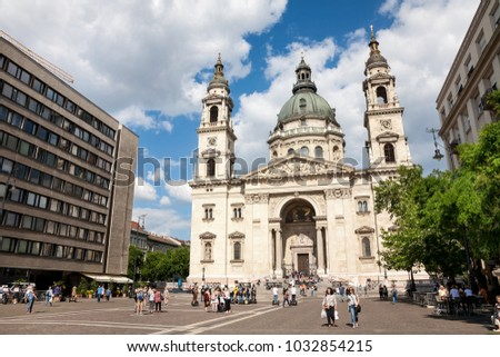 Budapest, Hungary - 2017, May 26 : People in front of the facade of the St. Stephen cathedral in the Pest area of Budapest in Hungary, Eastern Europe
