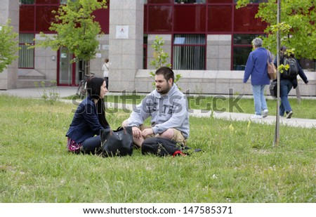 BUDAPEST, HUNGARY - MAY 14: Unidentified students resting  in the campus of the ELTE on May 14, 2013 in Budapest. Eotvos Lorand University (ELTE) is the largest and oldest university in Hungary.