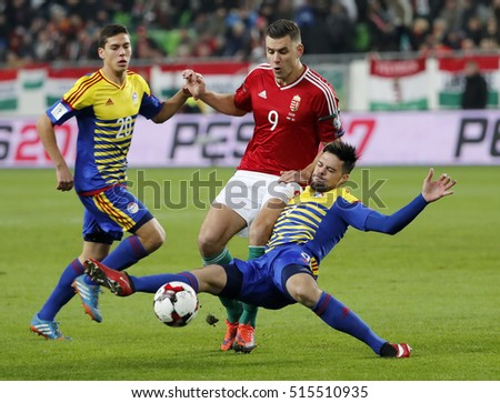 BUDAPEST, HUNGARY - NOVEMBER 13, 2016: Adam Szalai #9 of Hungary is tackled by Marc Vales #3 in front of Max Llovera #20 of Andorra during the Hungary v Andorra FIFA WC Qualifier at Groupama Arena.