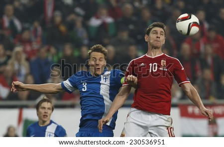 BUDAPEST, HUNGARY - NOVEMBER 14, 2014: Air battle between Hunagrian Zoltan Gera (r) and Finnish Niklas Moisander during Hungary vs. Finland UEFA Euro 2016 qualifier football match in Groupama Arena.