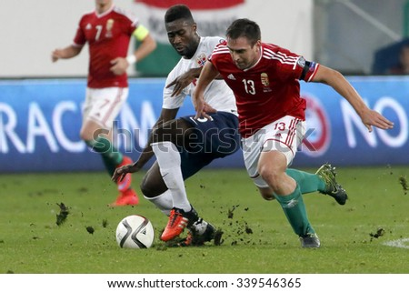 BUDAPEST, HUNGARY - NOVEMBER 15, 2015: Duel between Hungarian Daniel Bode (r) and Norwegian Alexander Tettey during Hungary vs Norway UEFA Euro 2016 qualifier play-off football match at Groupama Arena - stock photo