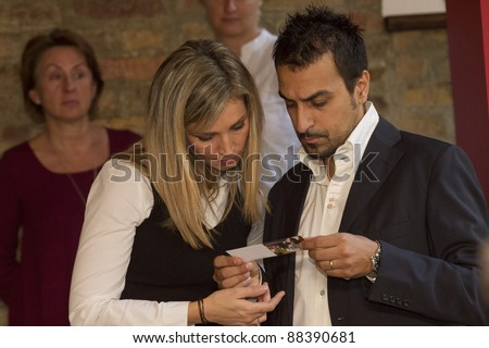 BUDAPEST, HUNGARY - NOVEMBER 8: Eva Novodomszky, anchor of the Hungarian state TV and her husband on the press conference of the 1st Taste and Wine Exposition on November 8, 2011 in Budapest Hungary.